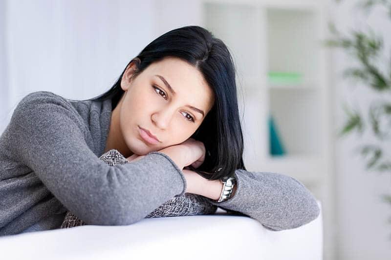 mindful sad woman looking away