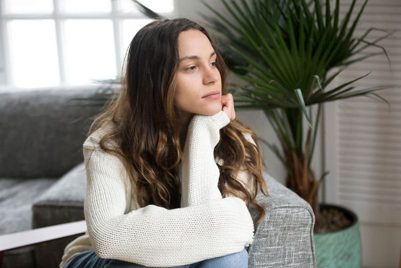 mindful young woman sitting in the living room