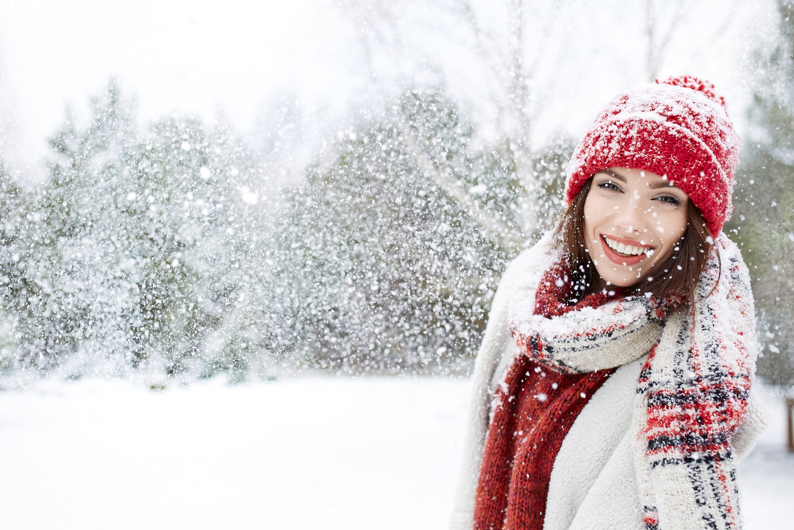 portrait of a smiling girl in the snow outside