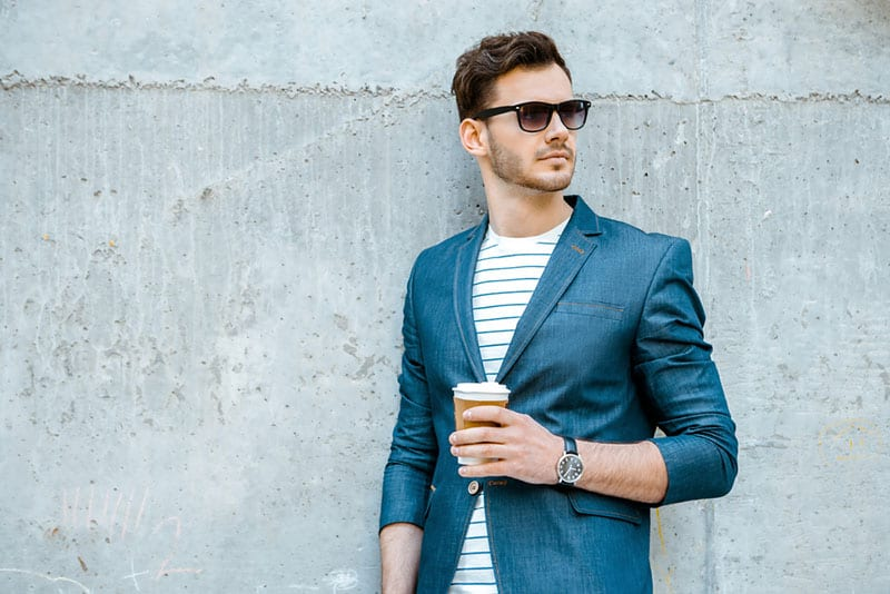 stylish man posing with cup