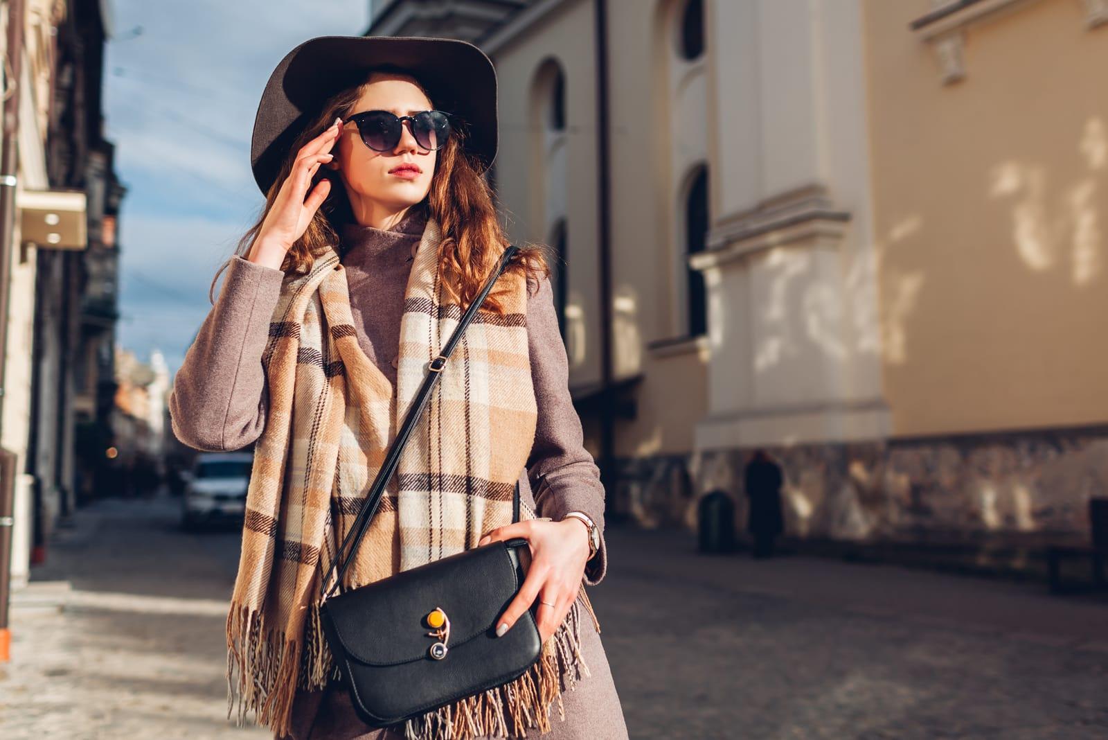stylish young woman wearing hat