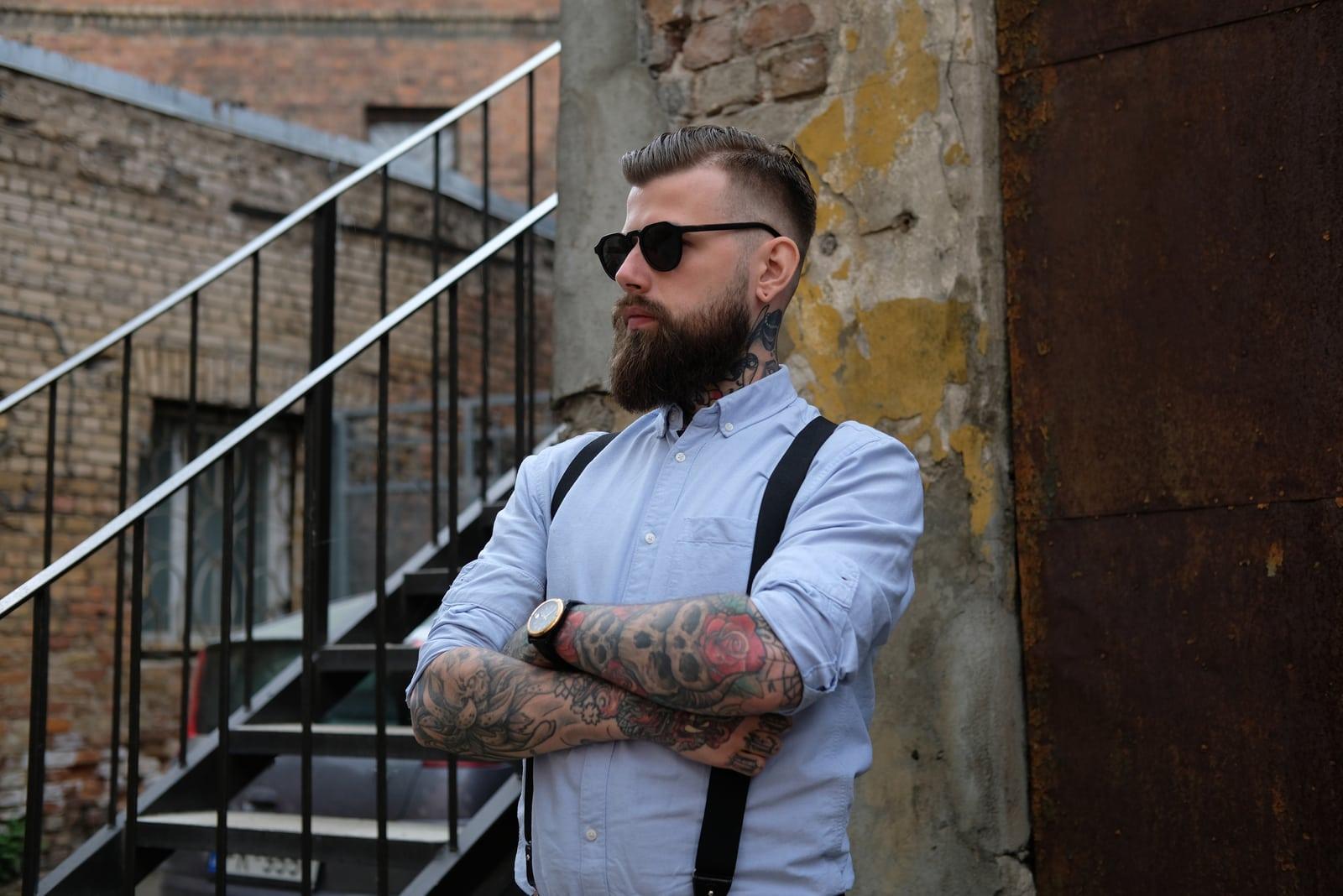tattooed man wearing sunglasses