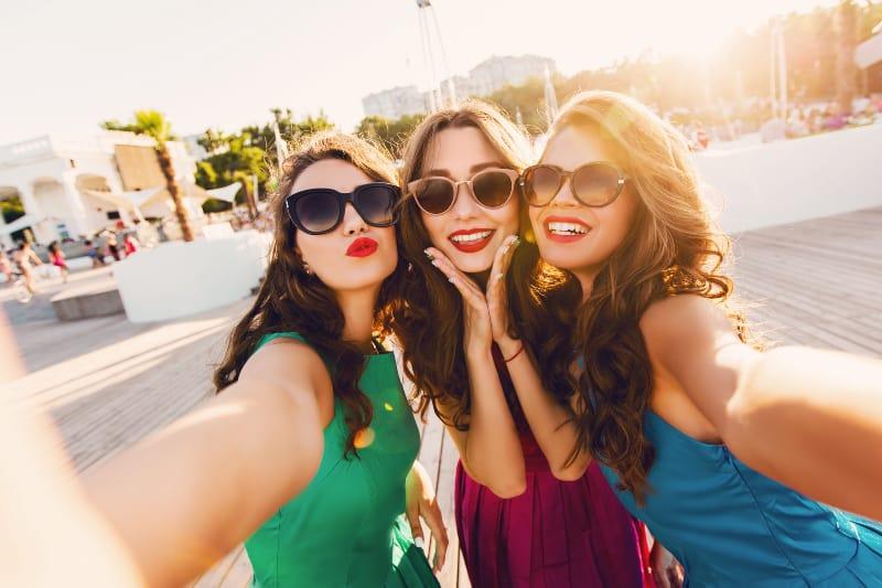 three female friends taking selfie