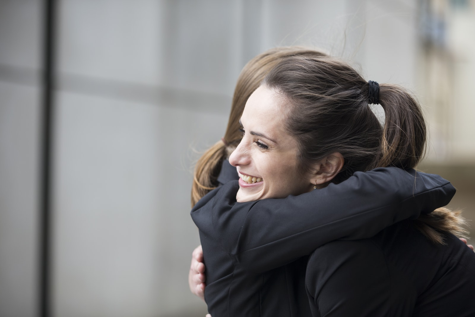 two women hug