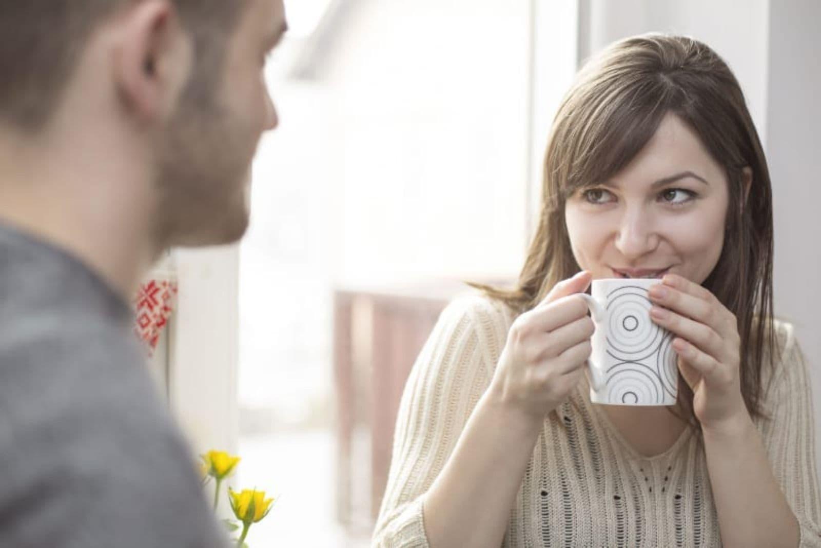 woman drinking tea and listening to hey boyfriend