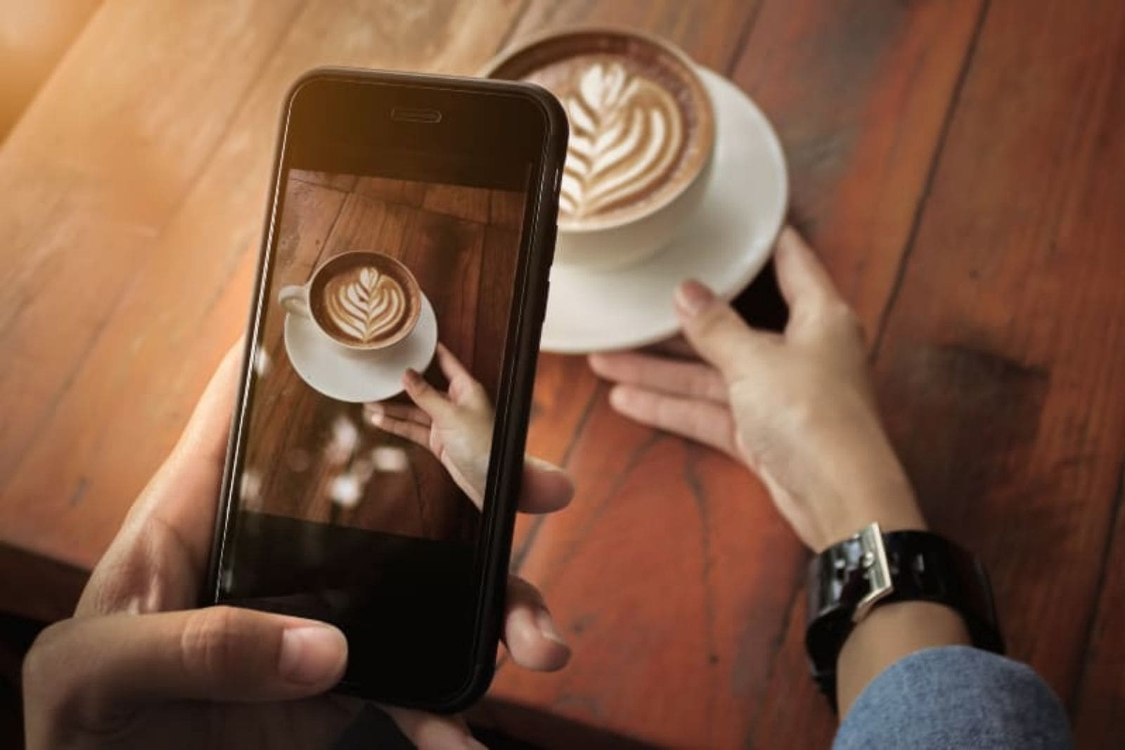 woman taking a photo of coffee