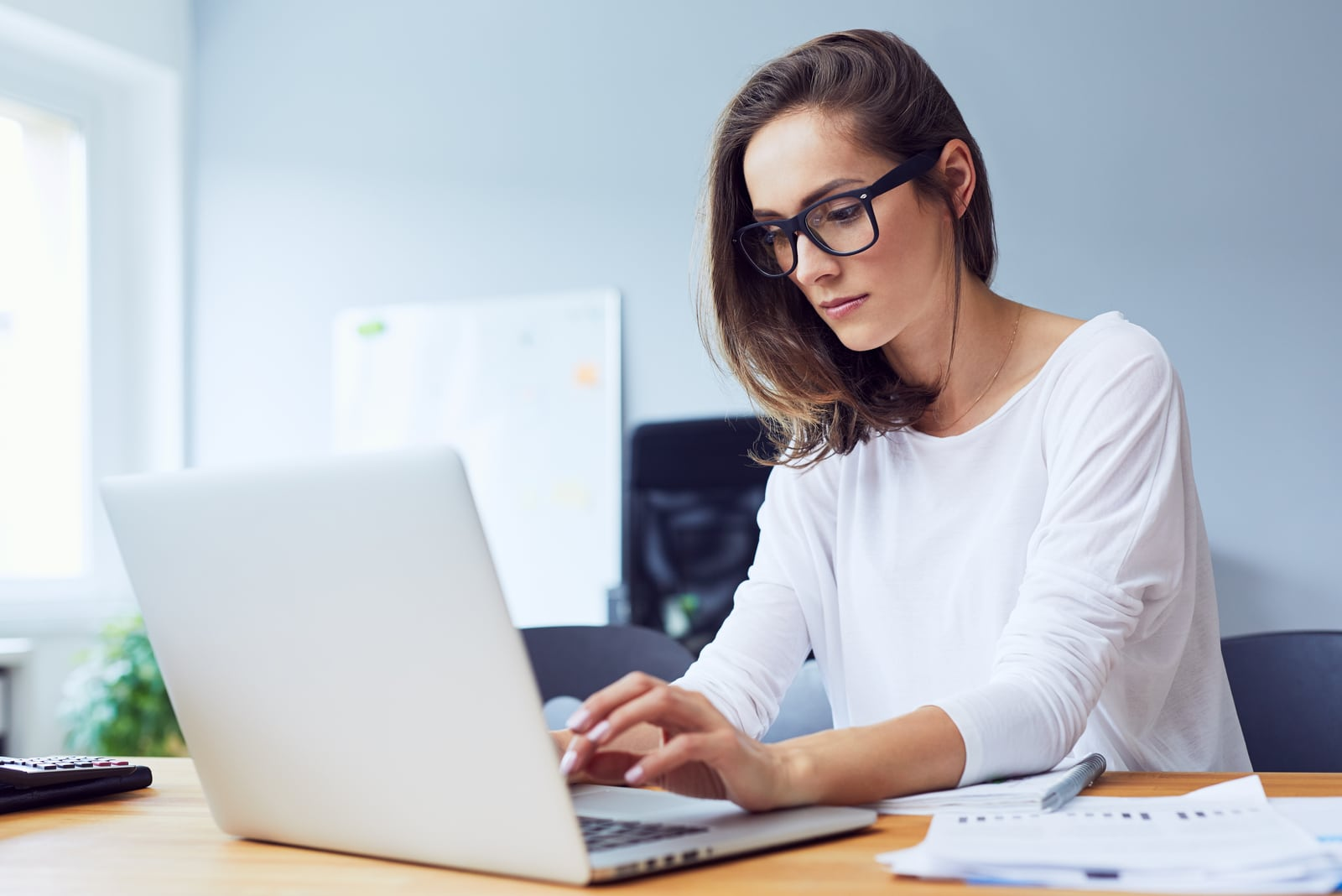young beautiful businesswoman working on laptop