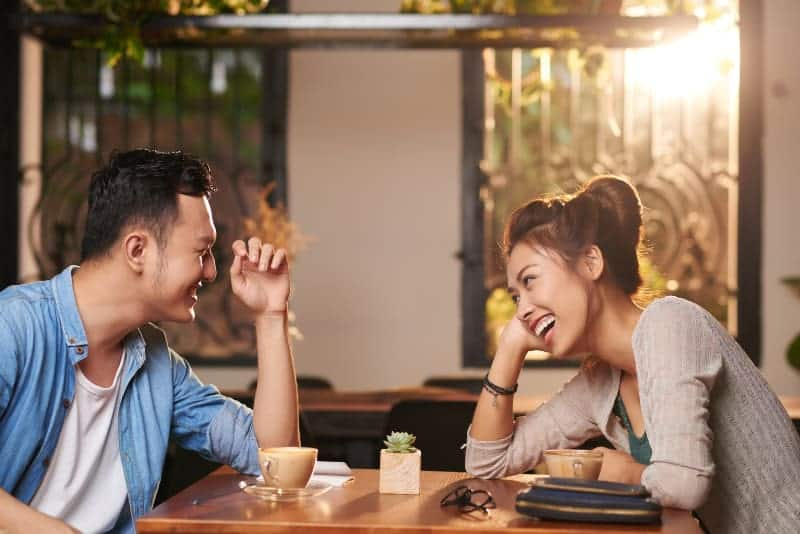 Cheerful couple in cafe