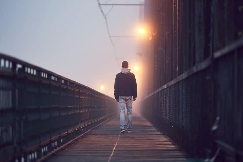 Guy walking alone
