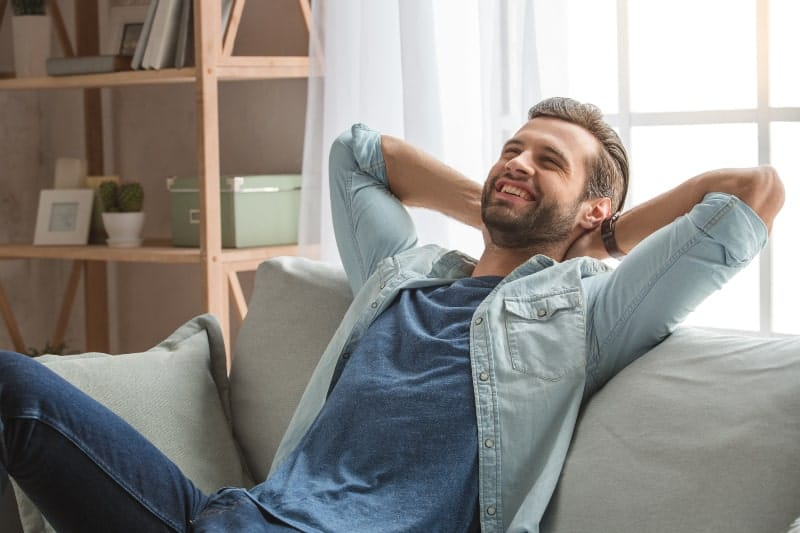 Happy guy sitting on couch