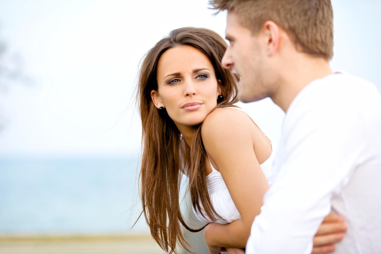 serious woman looking at man outdoor