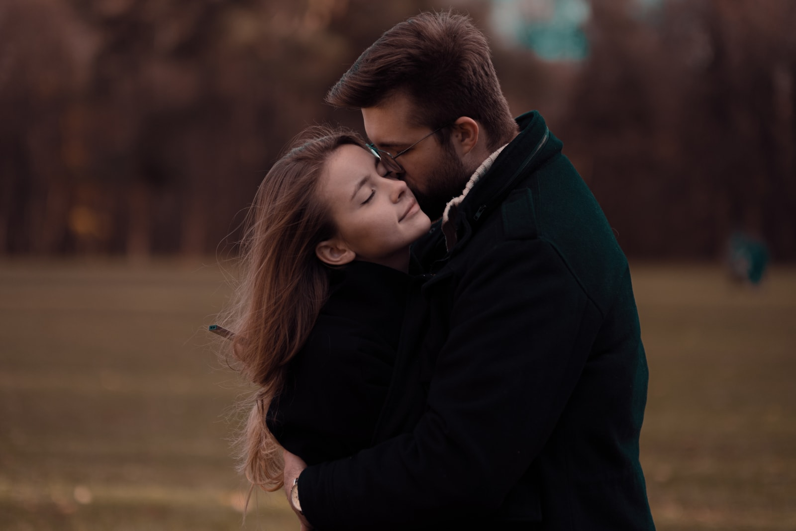 a loving couple kissing in nature