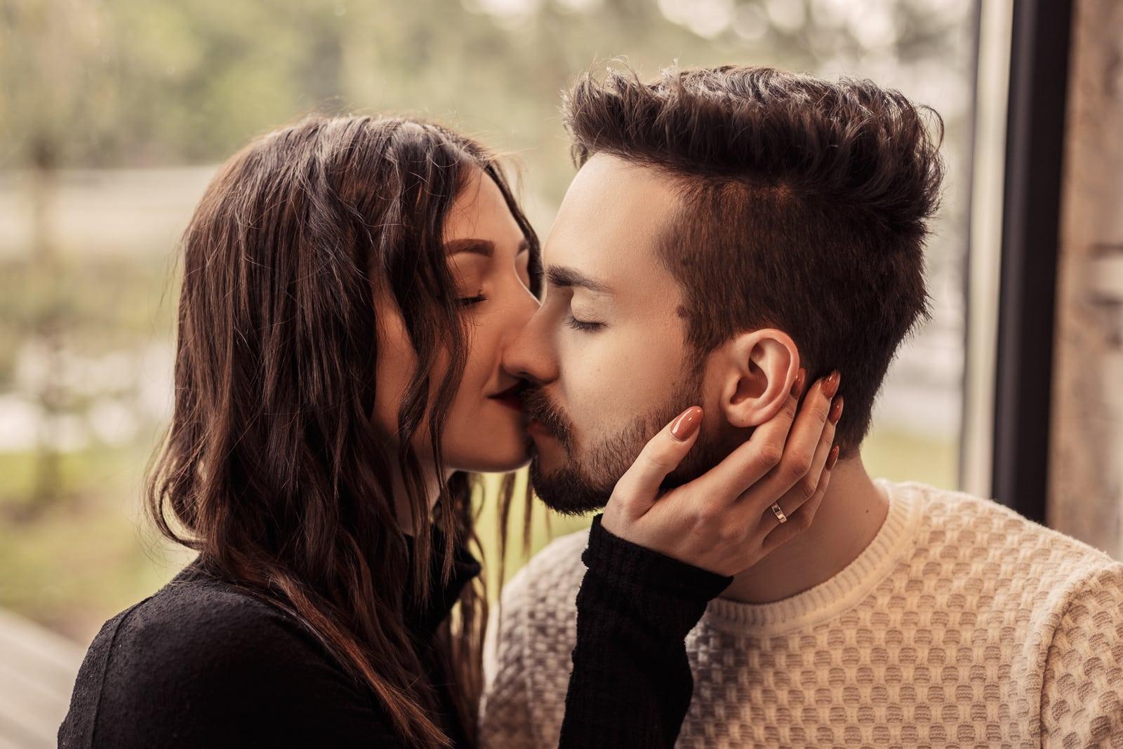 a loving couple passionately kiss
