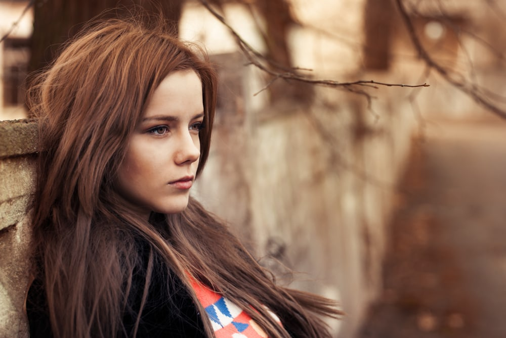 a portrait of a beautiful thinking brunette