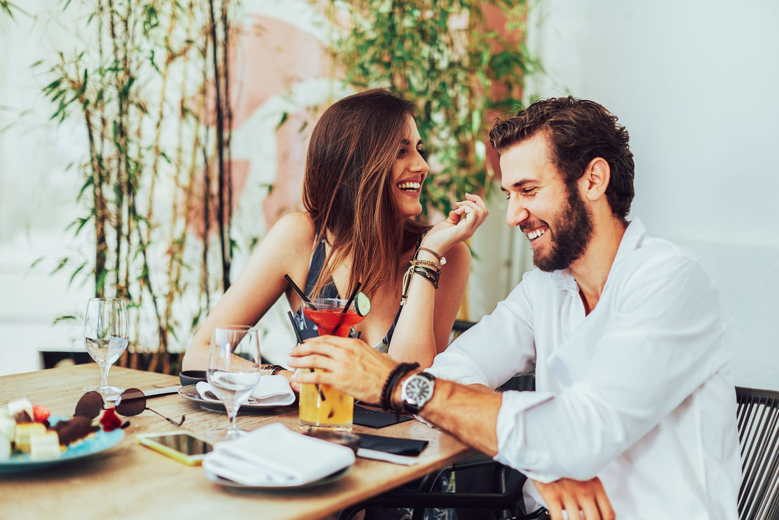 a smiling couple having fun in a cafe