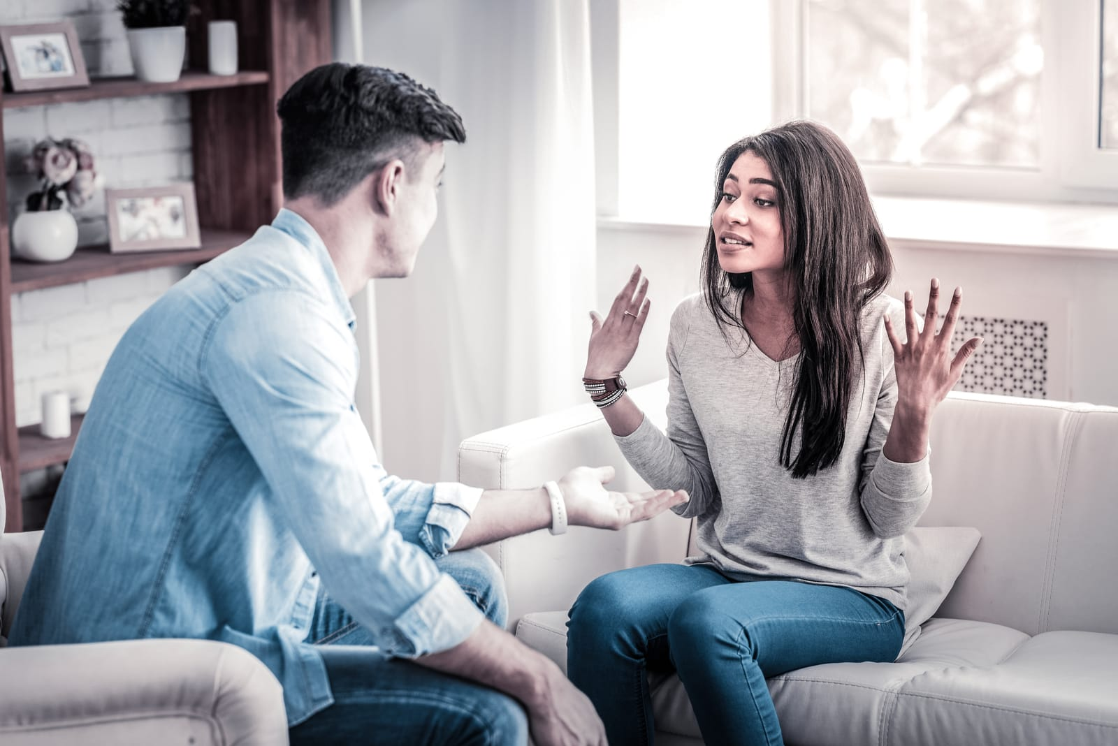 a young couple has an argument in the house