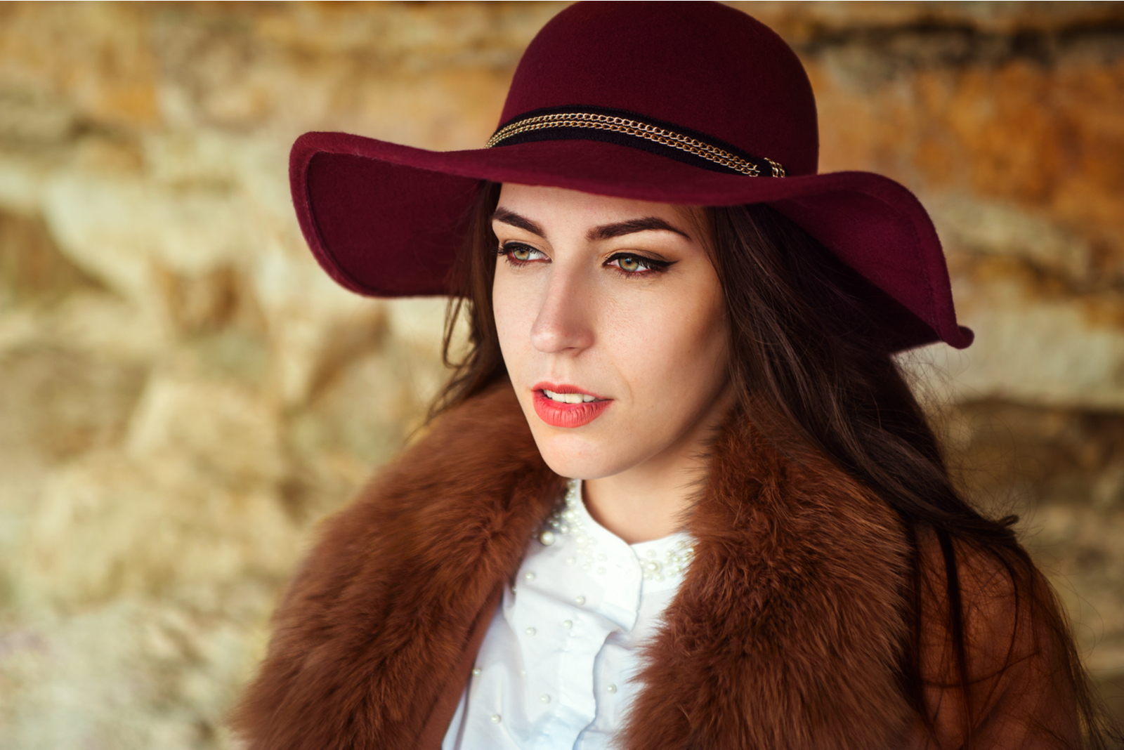 beautiful serious brunette with a hat