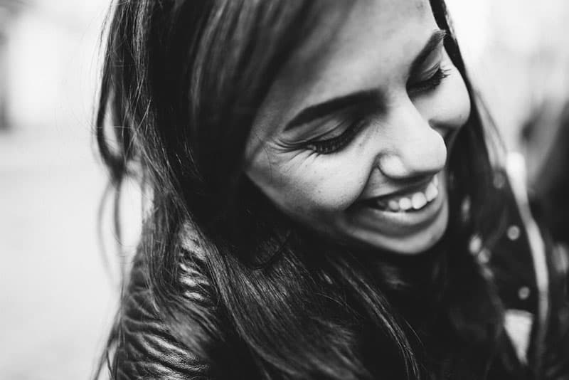 black and white portrait of happy young girl with beautiful hair