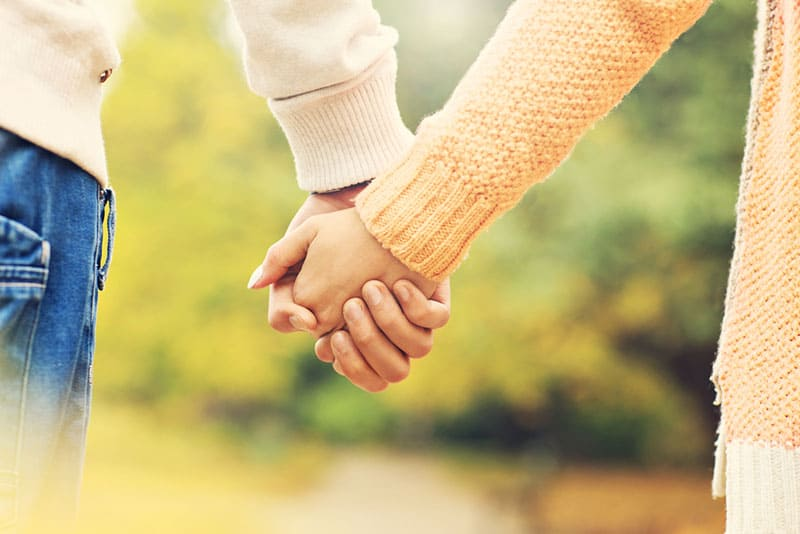 couple holding hands tight