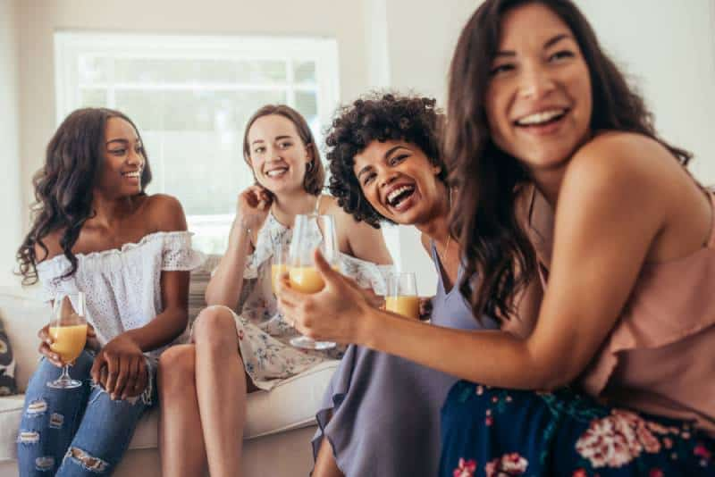group of female friends smiling at home