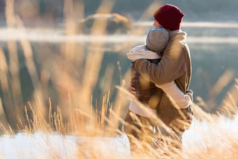 happy couple hugging in nature