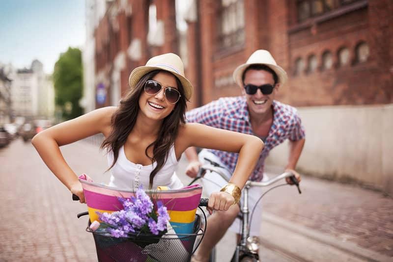 happy couple riding bikes