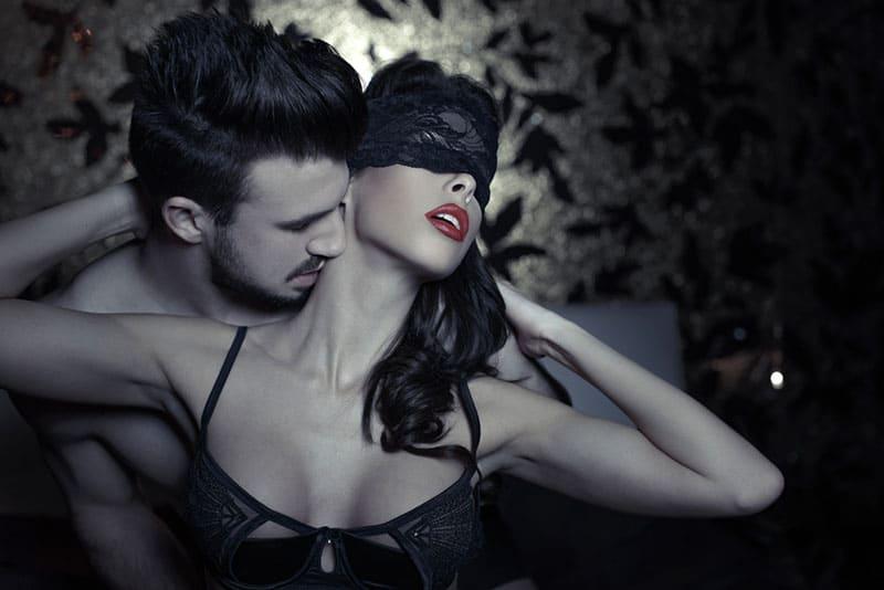 man kissing sexy woman