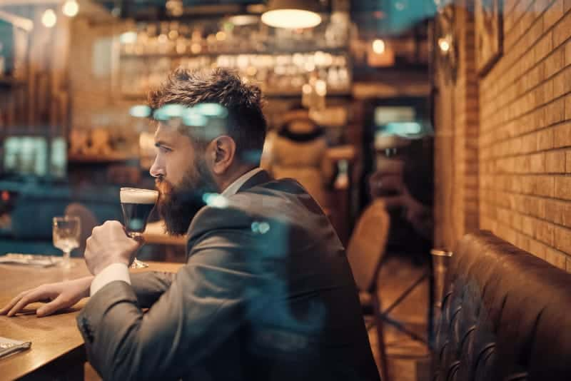 man wearing suit in restaurant