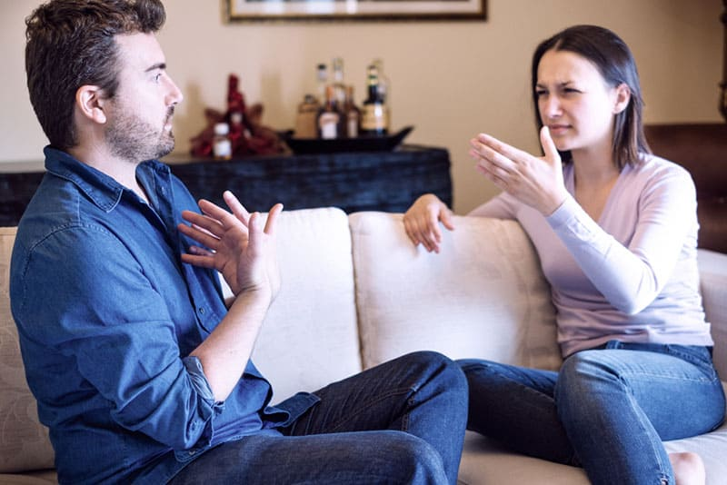 Sad couple with problems at home feeling bad and arguing