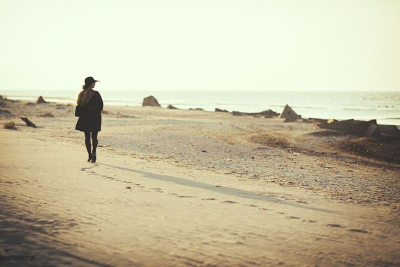 Woman walking away on the beach