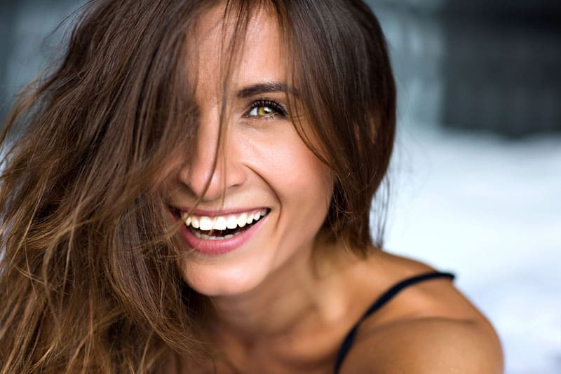 Close up morning portrait of smiling pretty woman with green eyes, sensual fresh happy face, positive emotions.