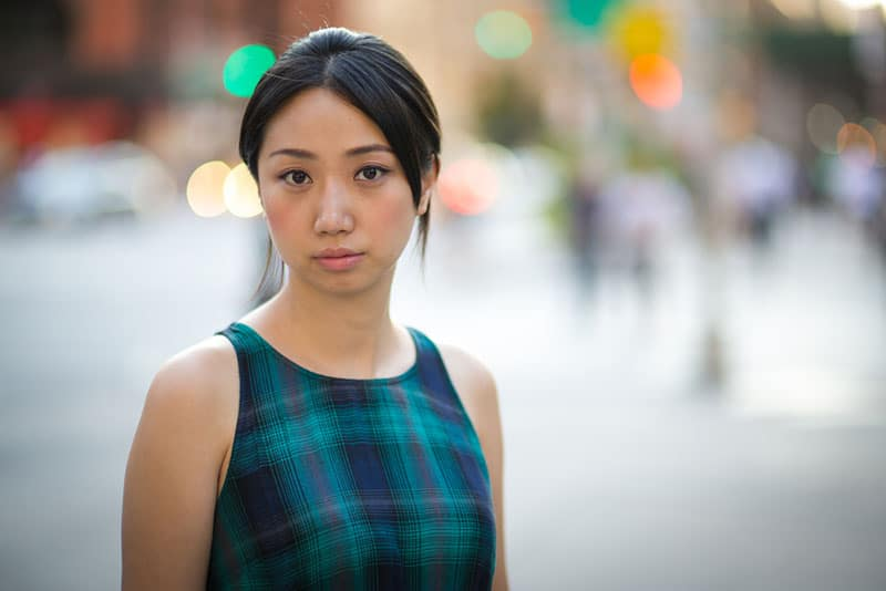Young Asian woman in New York City street serious face portrait
