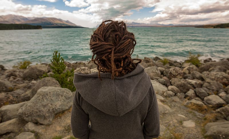 Rear view of a woman looking at lake, New Zealand