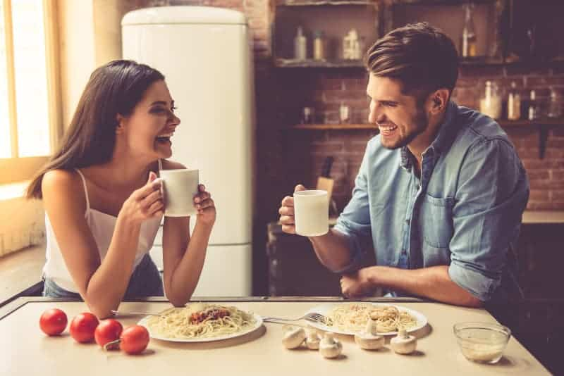smiling man and woman in the kitchen
