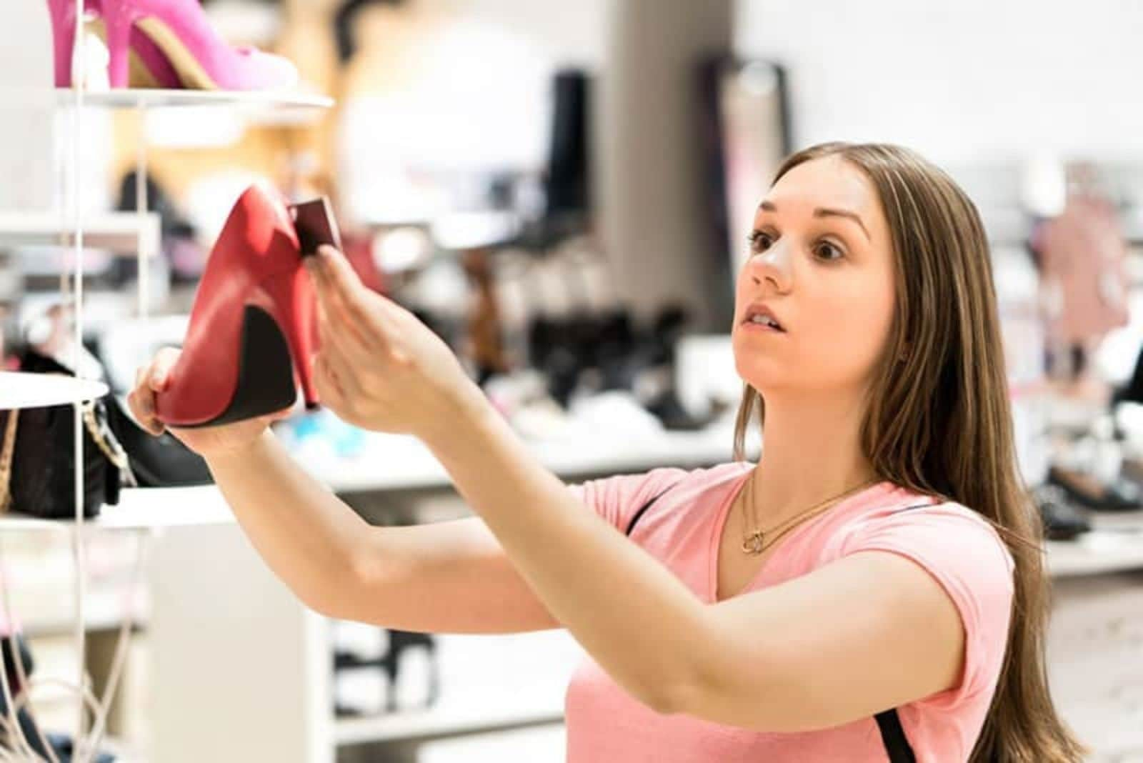 the woman measures the heel on the heels