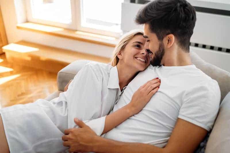 woman in love lying in man arms