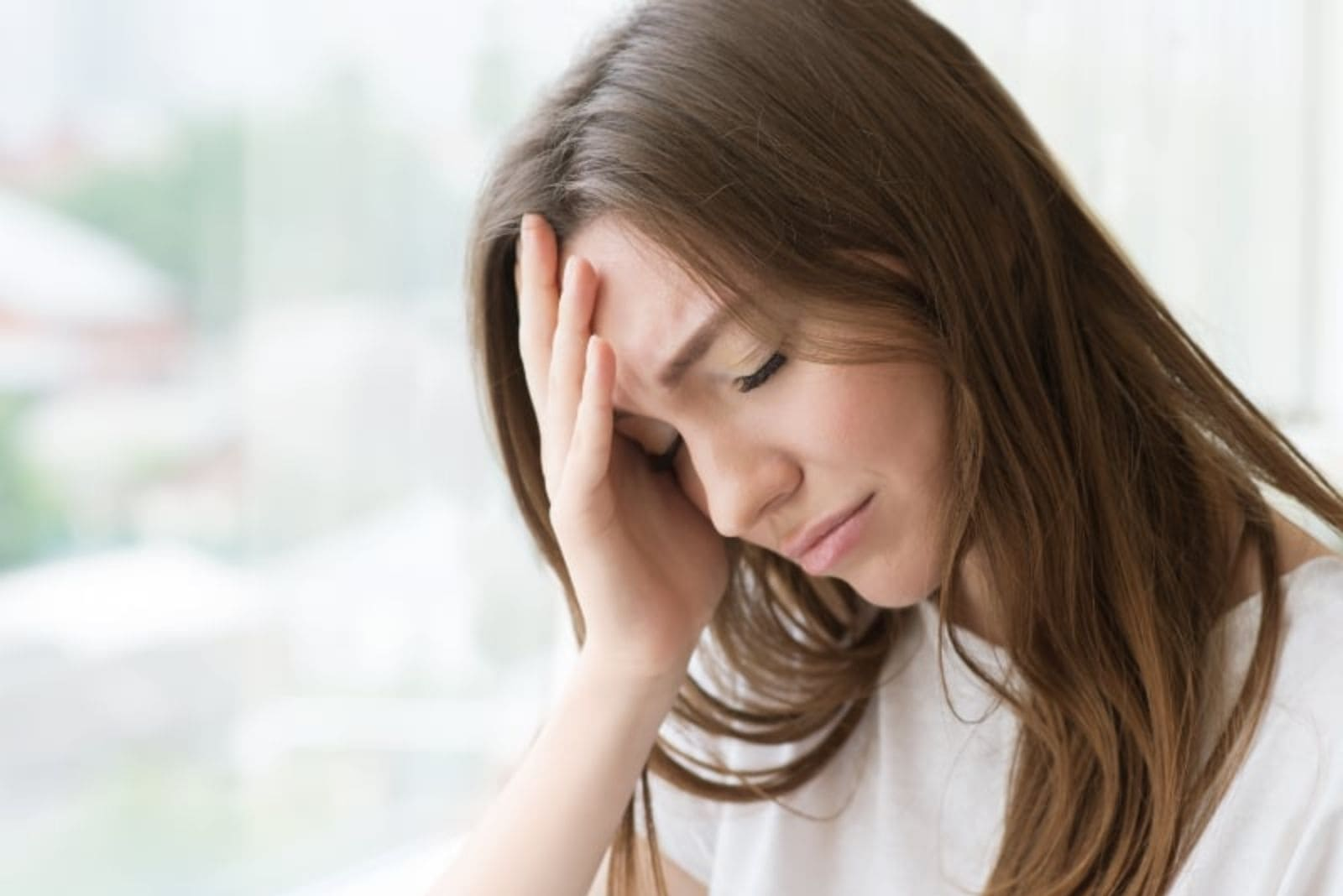 woman sad at home thinking about break up