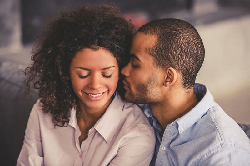 young man smelling woman