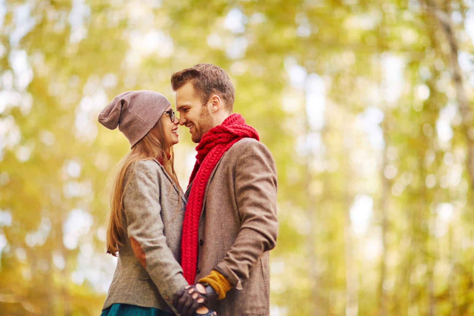 romantic couple standing in the wood