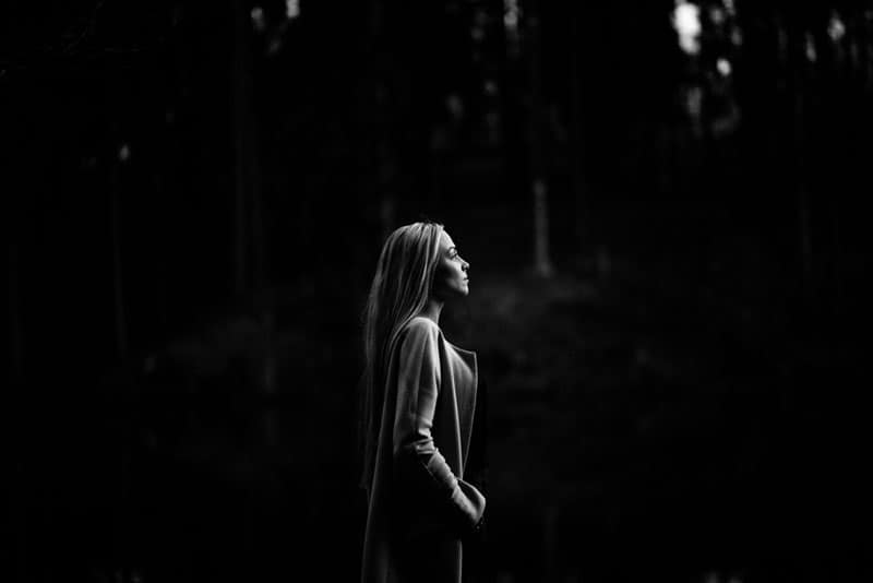 black and white portrait of a blonde woman in the woods