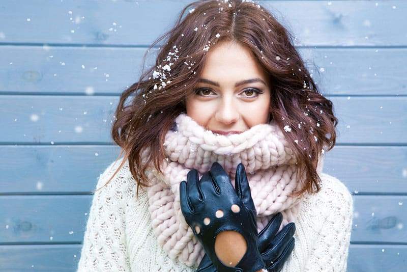 portrait of a beautiful woman with a scarf in winter