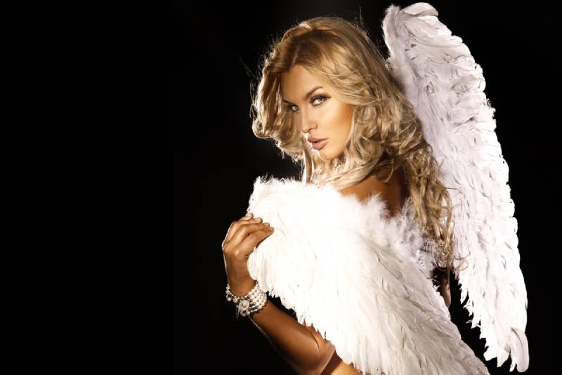 beautiful woman with long curly hair and angel's wings