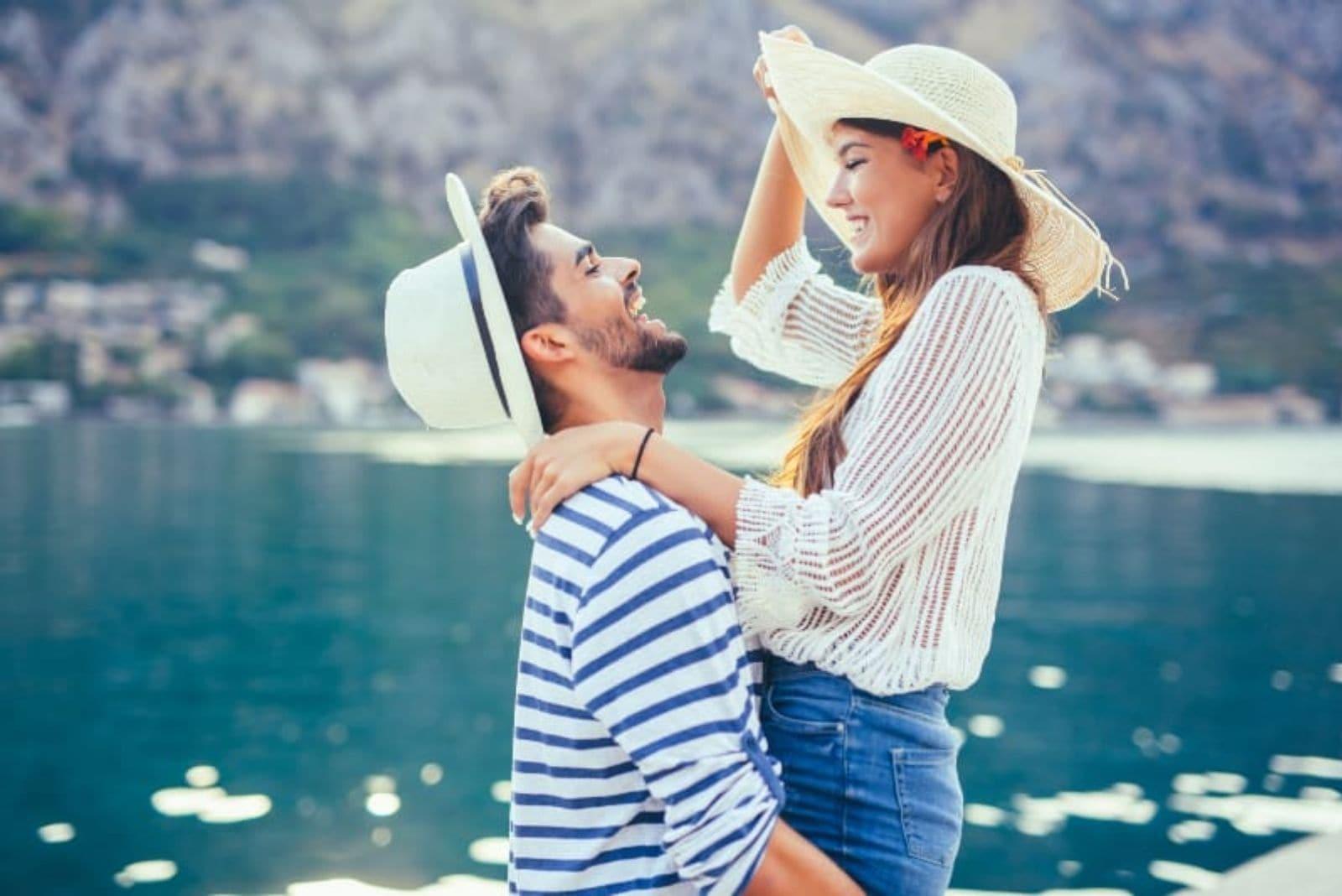 couple enjoying by the lake