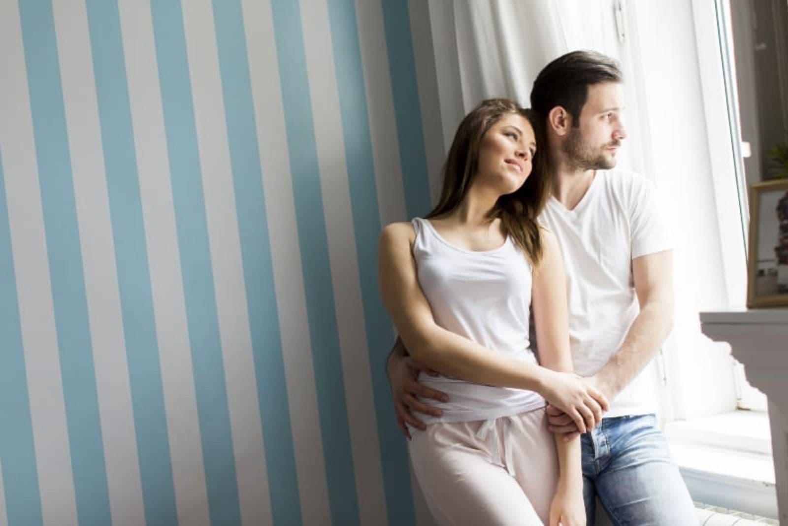 couple in love near window