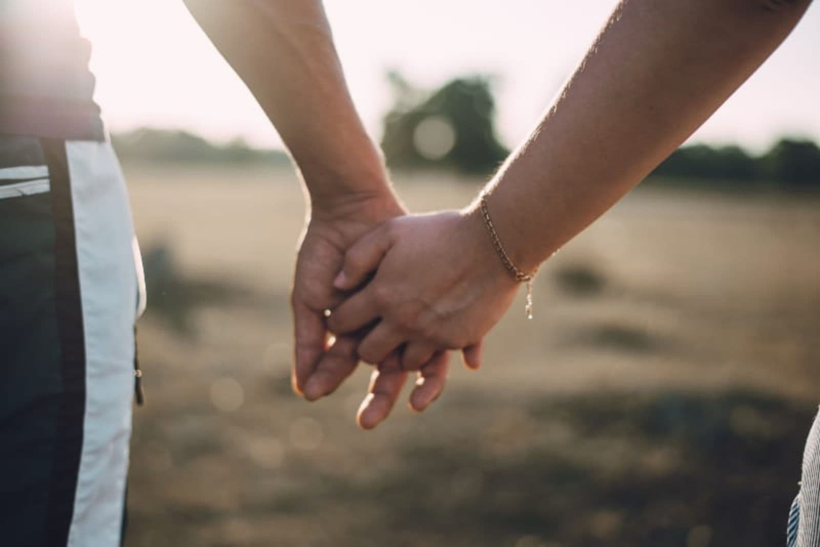 couple on picnic holding hands