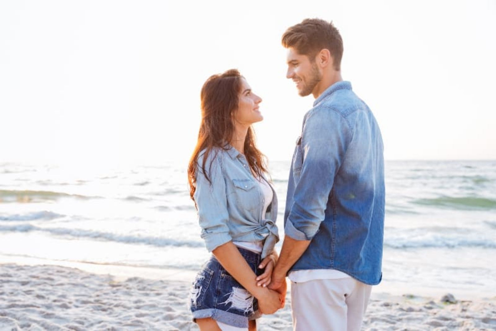 couple on the beach holding for hands