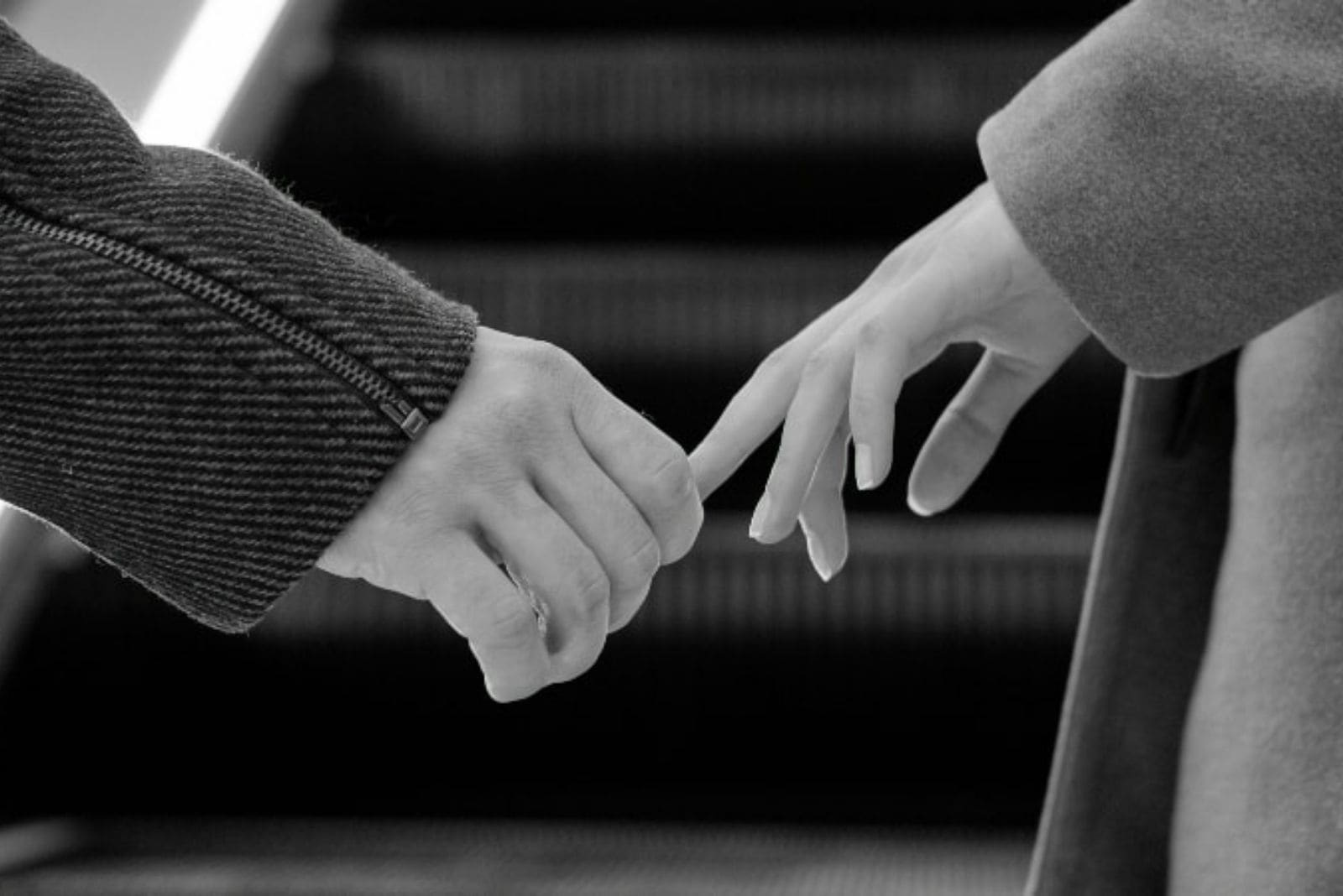 couple saying goodbye and holding hands
