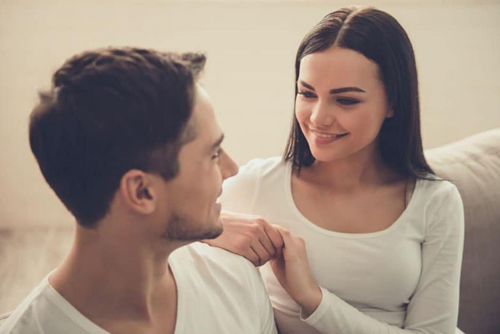 cute woman looking at man