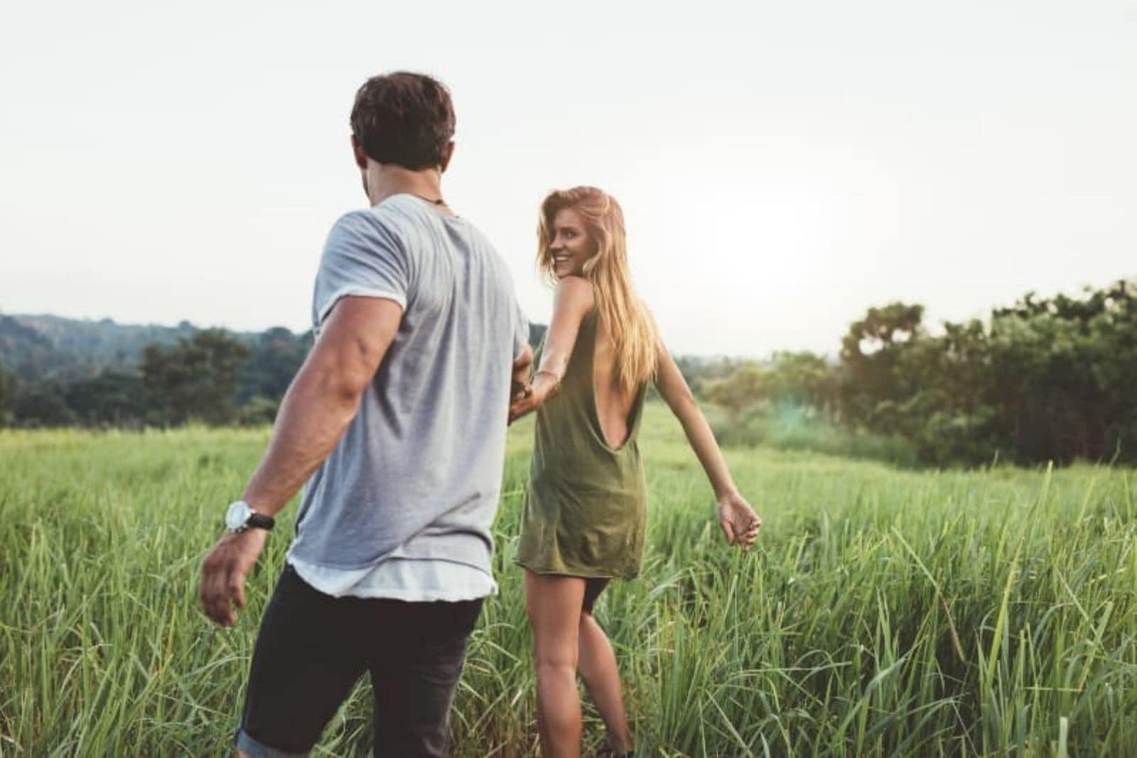 girl in green dress with her boyfriend having fun