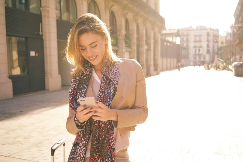 girl in the town holding phone
